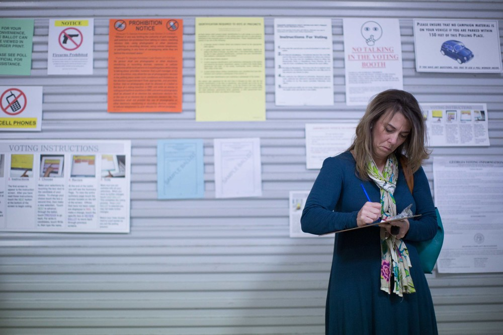 TAYLORSVILLE, GA - MARCH 1, 2016:  A Georgia voter fills out voting paper work before casting her ballot at a fire station on Super Tuesday March 1, 2016, in Taylorsville, Georgia. Voters head to the polls to cast their votes on Georgia's presidential primary. (Photo by Branden Camp/Getty Images)