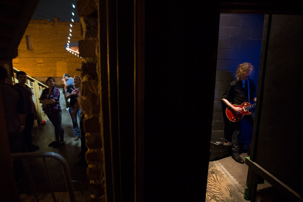 Guitarist Peter Stroud, right, waits backstage as fans crowd around outside The Crazy Bull music venue in Macon, Ga.  Stroud is Sheryl Crow's guitarist and has played for artist such as Don Henley, Sarah McLachlan, The Dixie Chicks and Shawn Mullins).