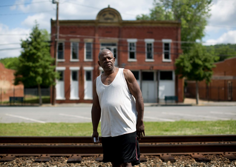 Kingston, Georgia resident Ronald Lee poses for a photo in downtown Kingston, Friday, May 13, 2016. Kingston, like many small American towns, are becoming vacant. Lee says that due to extremely low water pressure, businesses don't have sufficient water pressure to operate their businesses. Photo by Branden Camp