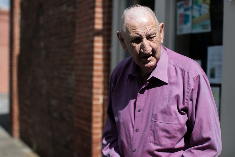 86-year-old G.B. Hood, who has lived in Kingston his whole life, exits a local convenience store in downtown Kingston, Ga.