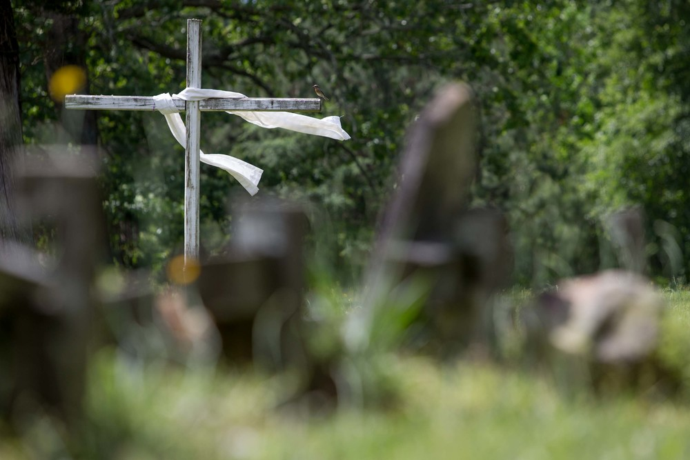 A cross sits on display inside a cemetery in Kingston, Ga.
