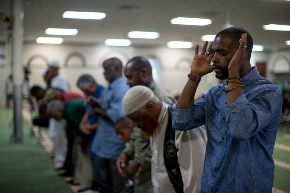 June 9, 2016 - Atlanta, Ga, U.S - Muslim men pray before an interfaith service at the Atlanta Masjid of Al Islam mosque in Atlanta. People gathered to honor the late Muhammad Ali, who died on June, 3, 2016, in Phoenix, Arizona.