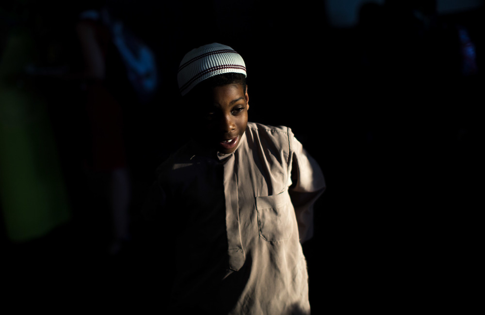 June 9, 2016 - Atlanta, Ga, U.S -Light shines on the face of a young boy at the Atlanta Masjid of Al Islam mosque in Atlanta. People gathered to honor the late Muhammad Ali, who died on June, 3, 2016, in Phoenix, Arizona.