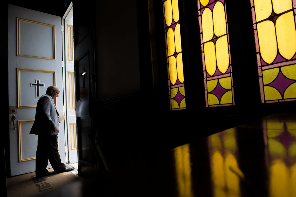 A parishioner at First Baptist Church, a predominantly African-American congregation, leaves after a worship service in Macon, Ga., on Sunday, July 10, 2016. There are two First Baptist Churches in Macon, one black and one white. (AP Photo/Branden Camp)