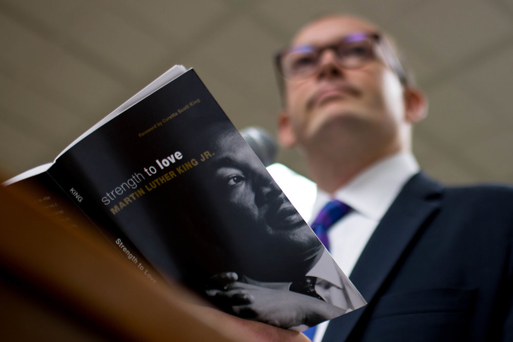 "The Rev. Scott Dickison teaches from a book of sermons by Martin Luther King Jr. during a Sunday School class at the First Baptist Church of Christ, a predominantly white congregation, in Macon, Ga., on Sunday, July 10, 2016. This class was held days after the fatal police shootings of Alton Sterling in Louisiana and Philando Castile in Minnesota, and the fatal ambush on Dallas police. ""It's weeks like these when we need more than ever to be with God's people,"" Dickison told the roomful of congregants. (AP Photo/Branden Camp"