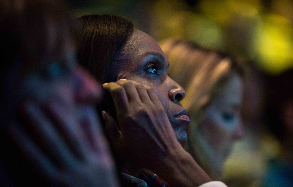 Women listen to a speaker at a conference in Orange County, Calif.  Photo by Branden Camp