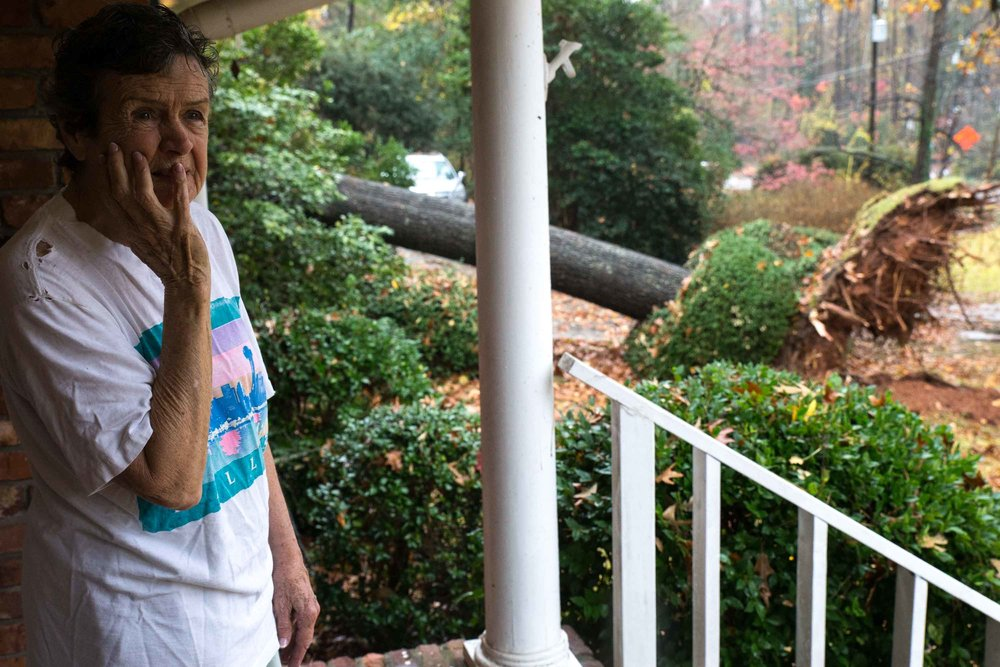 Martha Jane Jones, 88, reacts to the damage outside her Atlanta home, where a tree fell after severe thunderstorms rolled through the metro area on Wednesday, Nov. 30, 2016. Branden Camp for AJC