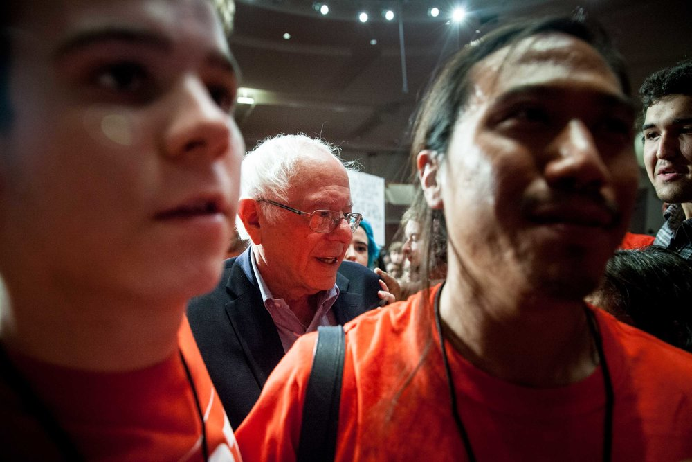 Volunteers for Atlanta mayoral candidate Vincent Fort lead U.S. Sen. Bernie Sanders through a crowd of supporters following a campaign rally. Branden Camp for AJC