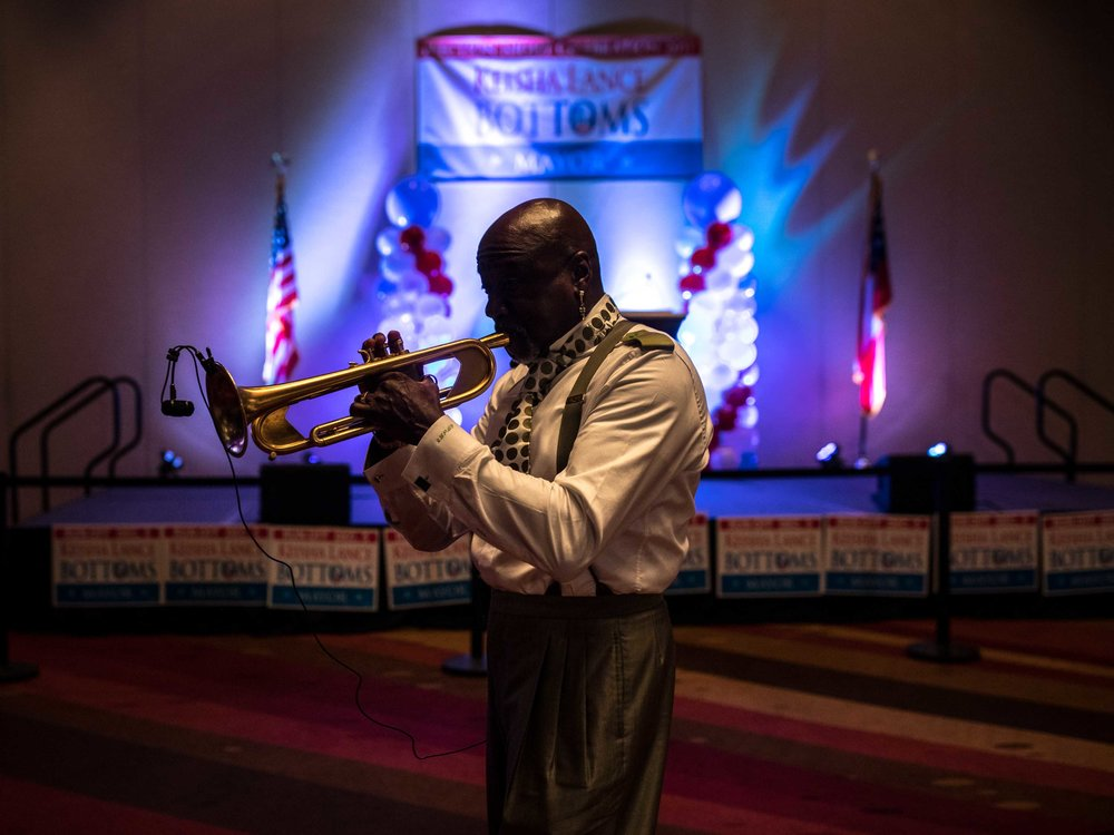 A trumpet player warms up during sound check for an election party for Keisha Lance Bottoms.