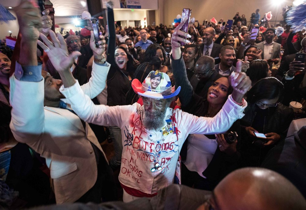 Supporters celebrate as results come in showing Bottoms winning over Mary Norwood.