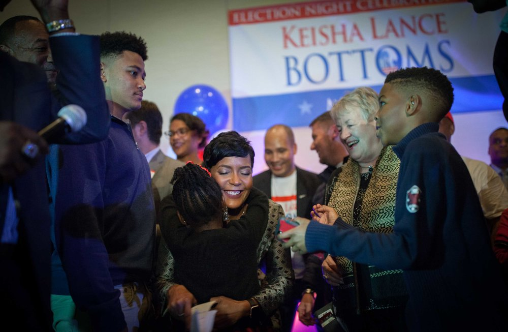 Keisha Lance Bottoms takes the stage after declaring victory over her opponent Mary Norwood.