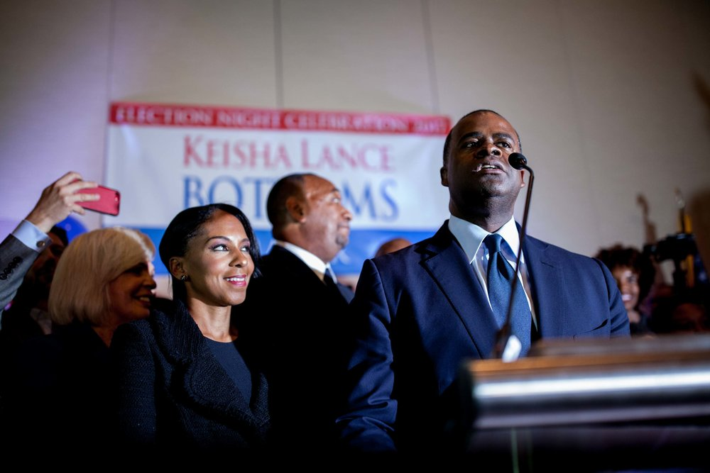Kasim Reed introduces Keisha Lance Bottoms during an election night party.