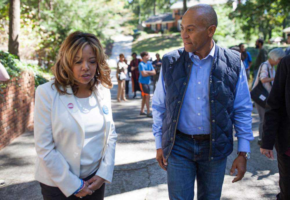 Democratic candidate for 6th District Lucy McBath, who is running against Republican Rep. Karen Handel, walks with former Governor of Massachusetts Deval Patrick, Saturday, Oct. 13, 2018, in Atlanta.
