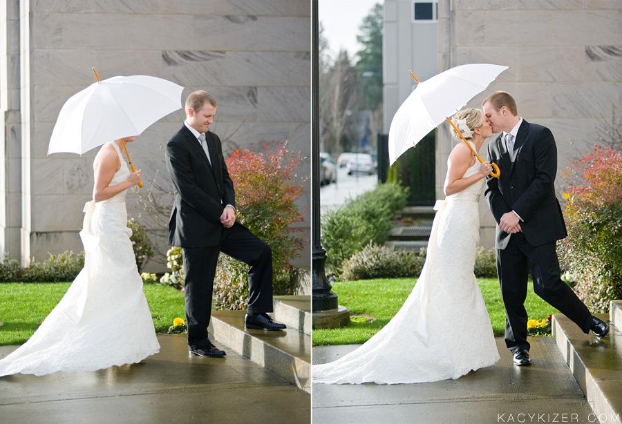 wedding first look under umbrella in rain