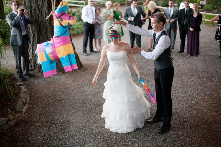 bride hits pinata at miller farm retreat
