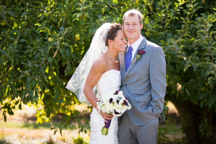 bride and groom at deterings orchard in harrisburg, oregon