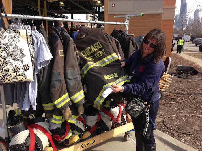 Costumer looks through fireman costumes