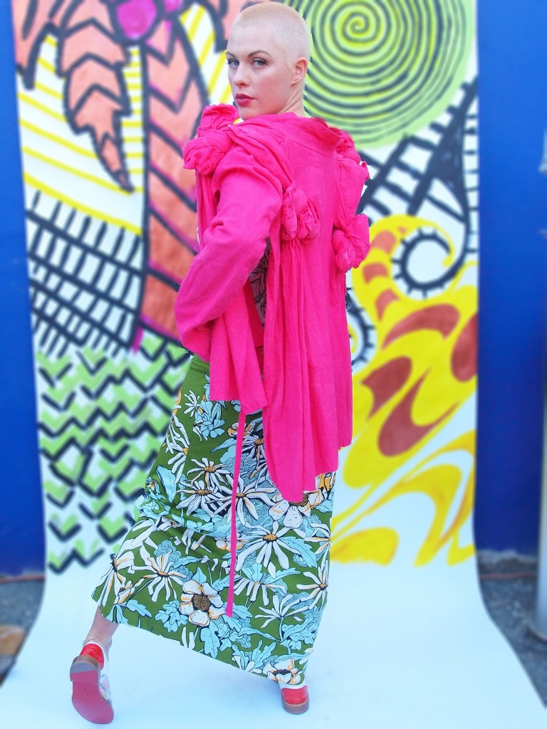 Comme des Garcons pink knot jacket.  1970s novelty print maxi dress.  Christian Louboutin oxfords.