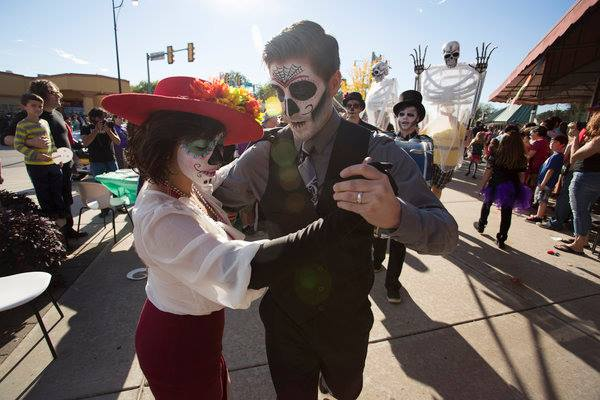 We made it in  a Huffington Post article for leading the Day of the Dead  parade in the Plaza District! Yes we we're dancing Tango the whole way.