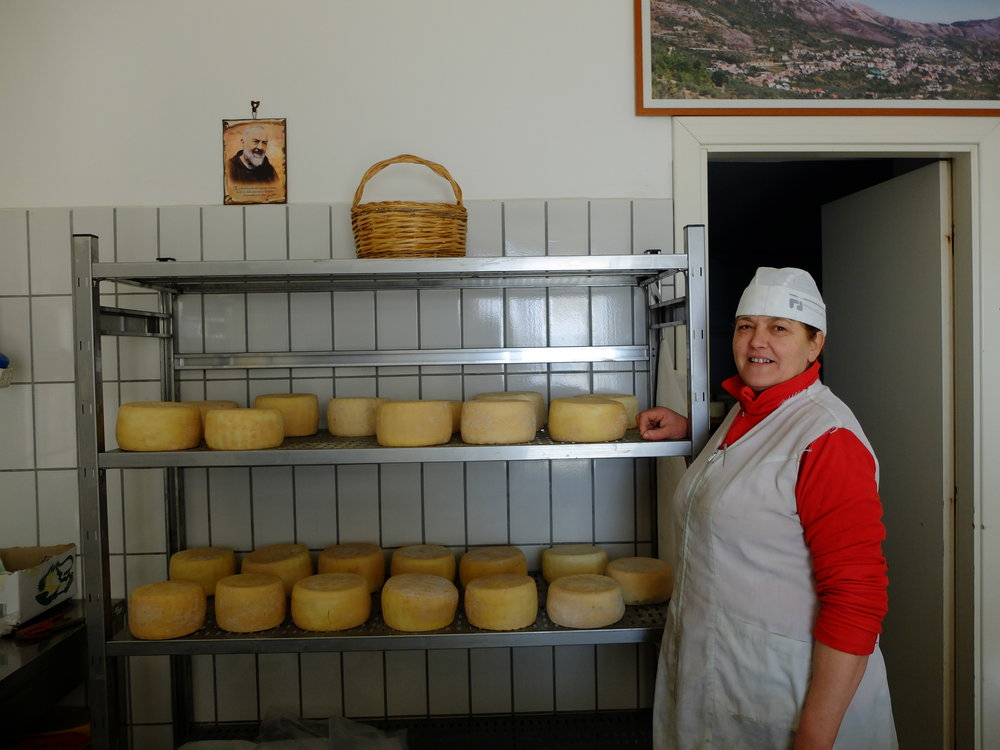 Immacolata proudly showing her cheeses