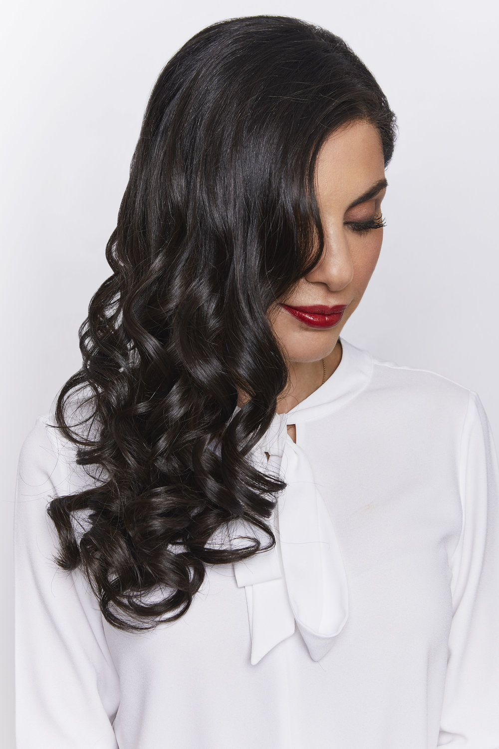 BE CURLY  Fun, fresh, and feminine - lots of bouncy curls.
