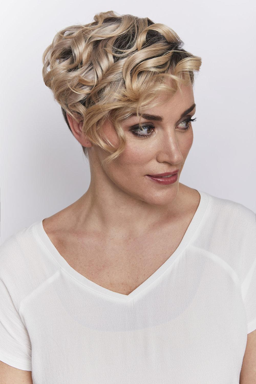 BE CURLY  Fun, fresh, and feminine - lots of bouncy curls.