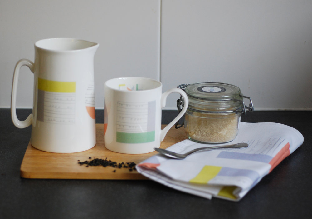 Collage bone china mug and jug with cotton tea towel