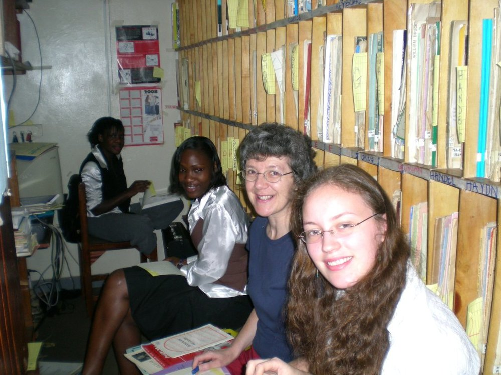 Karla, Bridget, Monicah and Maureen at work in the Kampala Music School Library.