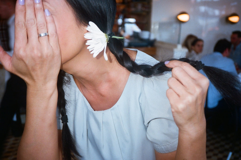 Waitress at Standard Grill holding her braid.jpg