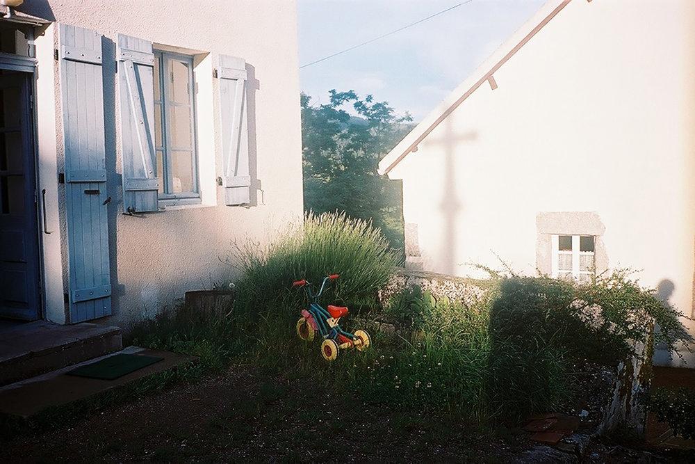 7 Joon's tricycle and a Cross shadow.jpg