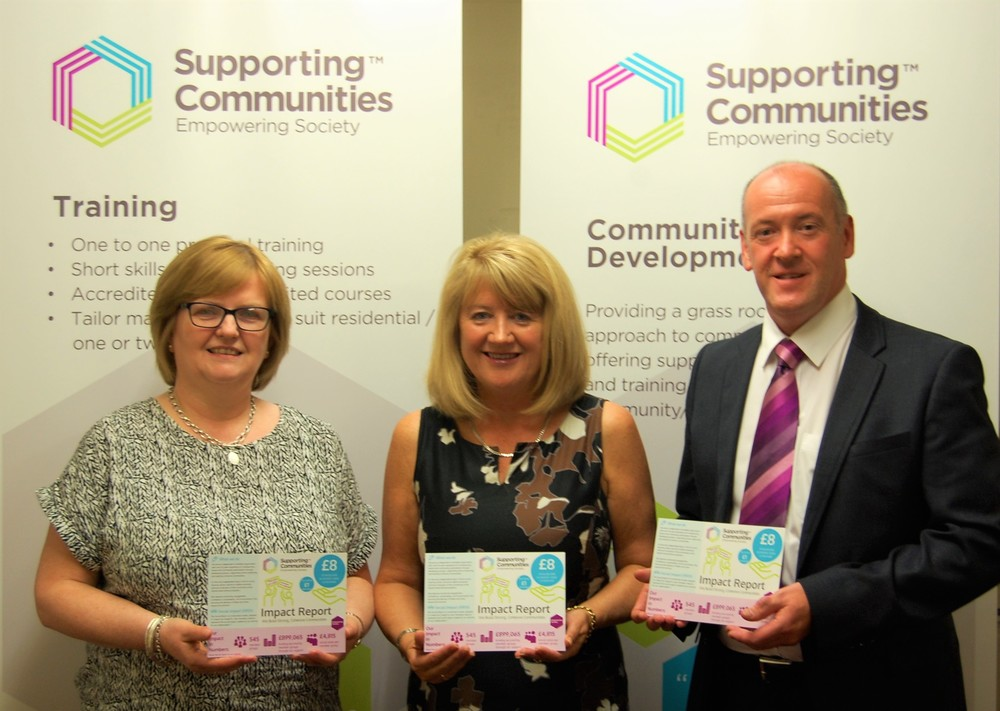 Theresa Patton, Lorraine Campbell, and Colm McDaid celebrate the positive impact report.