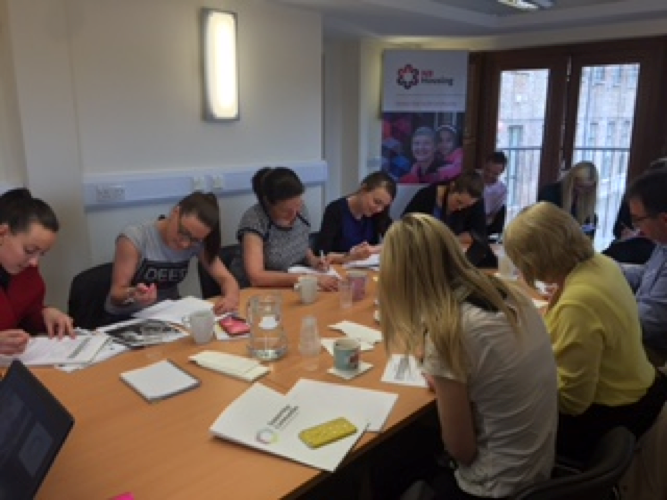 NB Housing staff members doing plenty of work at their training session