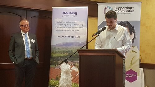 Paddy looks on as recent graduate (and now a Supporting Communities Development Officer) Ryan Young opens the final Student Housing Conference last year.