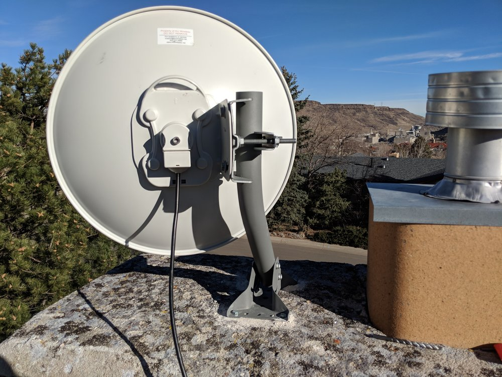 Dish radio mounted to j-bar attached to top of chimney