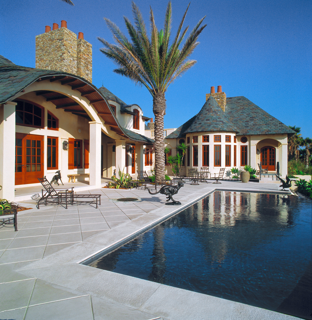 curved slate roof by pool