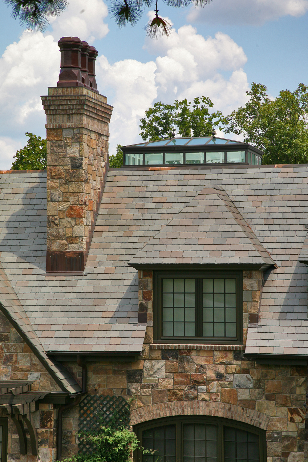 custom slate roof with rock siding