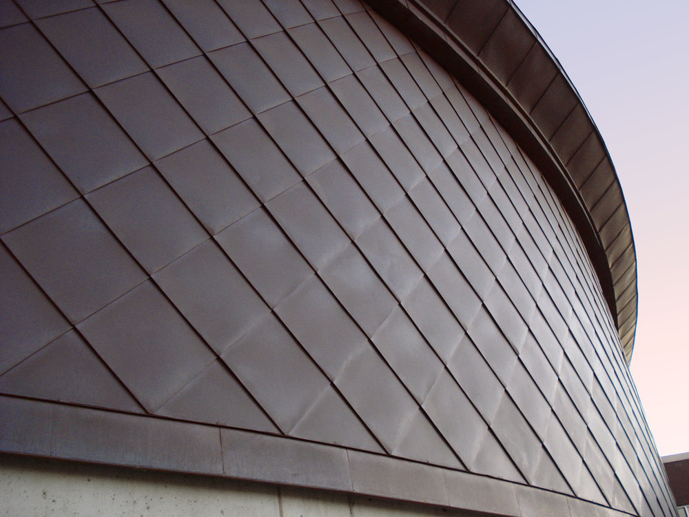 Oramental metal roof by Huber & Associates