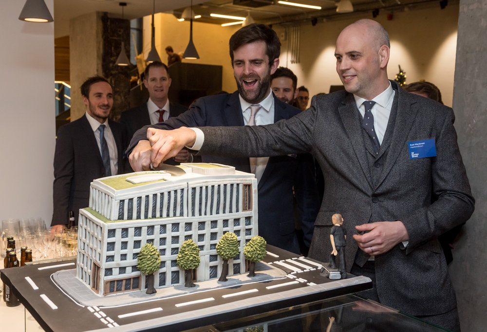 Euan MacDonald and Tom Noonan (Architects Hawkins/Brown) cut a cake version of the building during the official opening reception at the refurbished  Bartlett School of Architecture, 22 Gordon Street. London Hawkins/Brown architects