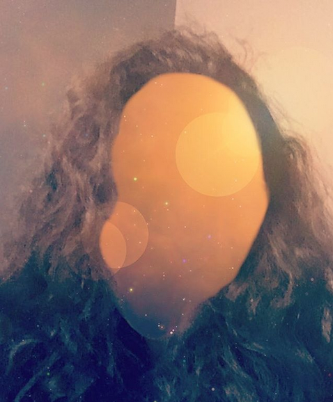 [image: selfie with face replaced by space image and lens flares]