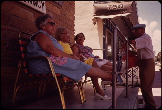 Residential Hotels for Retired Persons of Limited Means Dot the South Beach Area. The Front Porch Is a Favorite Gathering Place. U.S. National Archives' Local Identifier: 412-DA-6138 Photographer: Schulke, Flip, 1930-2008. Taken circa 1975.