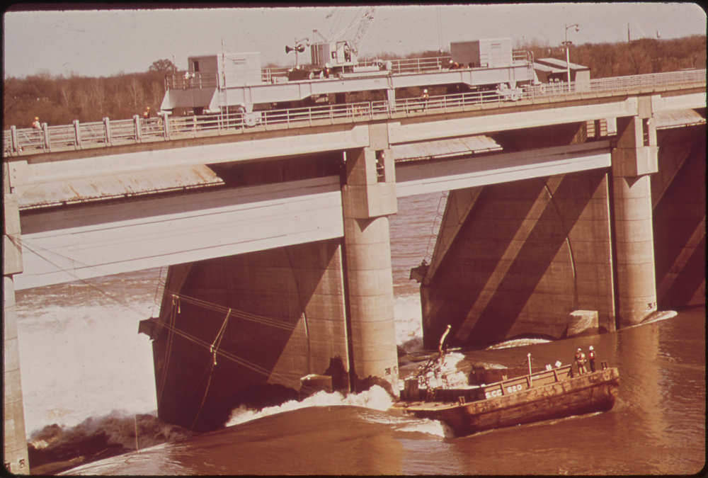 A Liquid Chlorine Barge, After Breaking Loose From Its Tug Became Lodged Against The Mcalpine Dam On The Ohio River And Could Not Be Set Free, March 1972. Images from the US National Archives.