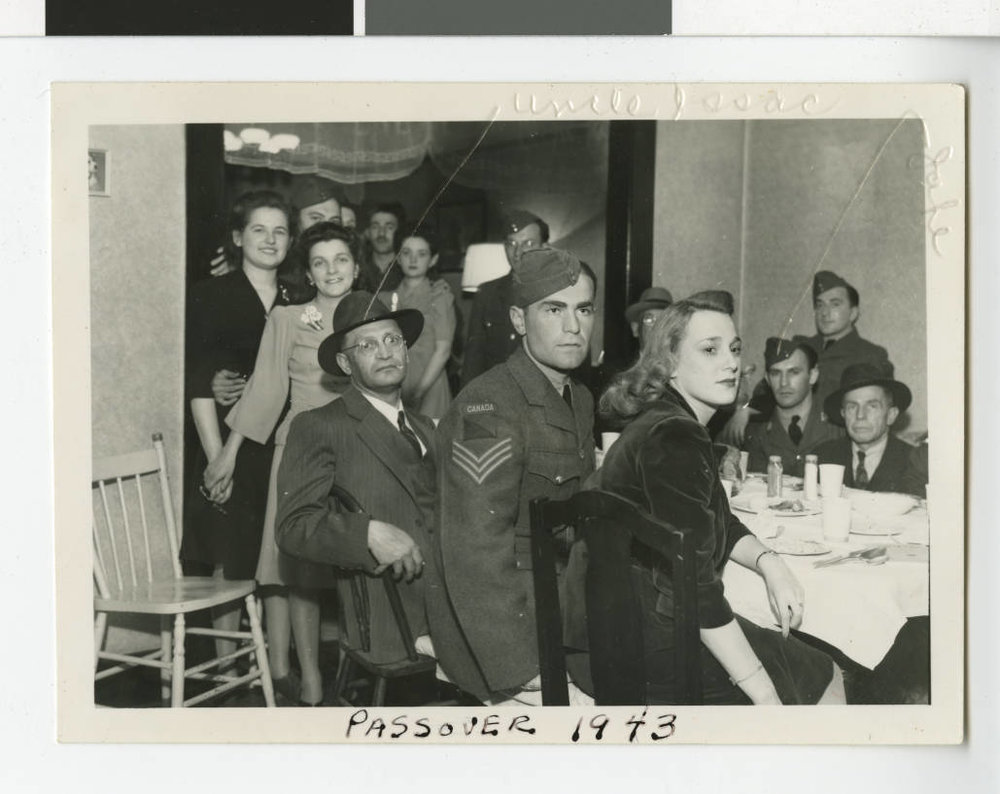 Family Passover gathering including family and friends of Irving and Sonia Leveneson, 1943.