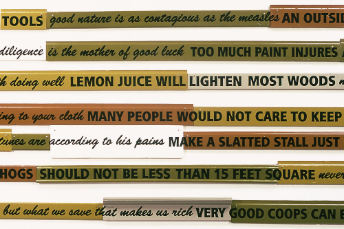 Inventive men  (detail of signboards) 2003 enamel paint on wood floor moldings, 250 linear feet overall