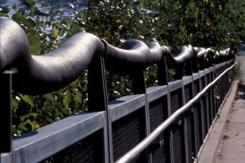 Bronze handrail on ramp (detail)