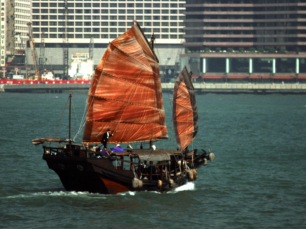 Image 2 shows the same image with secondary correction. The red of the sails and wooden hull are isolated and enriched using an HSL matte. Since the isolation is color based it does not need tracking. The extra color helps bring the junk forward in the picture, separating it from the background.