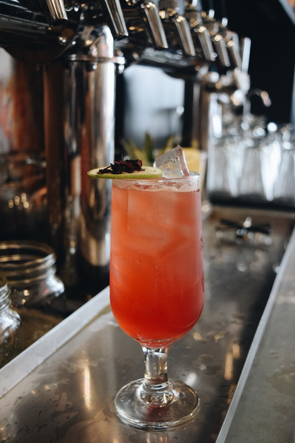 "Funky Sweed ""She's a dancing queen,"" made with Rowhouse Distilery Aquavit, Rum, lime, hibiscus Cordial, Egg White, Ninos Prickly beer. Photo by Sydney Countie"