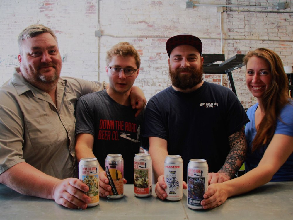 The Down the Road crew drinking some of their brews here at Dock Street Cannery. From Left to Right: Founder and Head Brewer Donovan Bailey; Antoine Martin, Director of Operations; Ian Snyder, former brewer at DTR and current Dock Street Brand Ambassador; Aubree Giarrossa, Events Director.