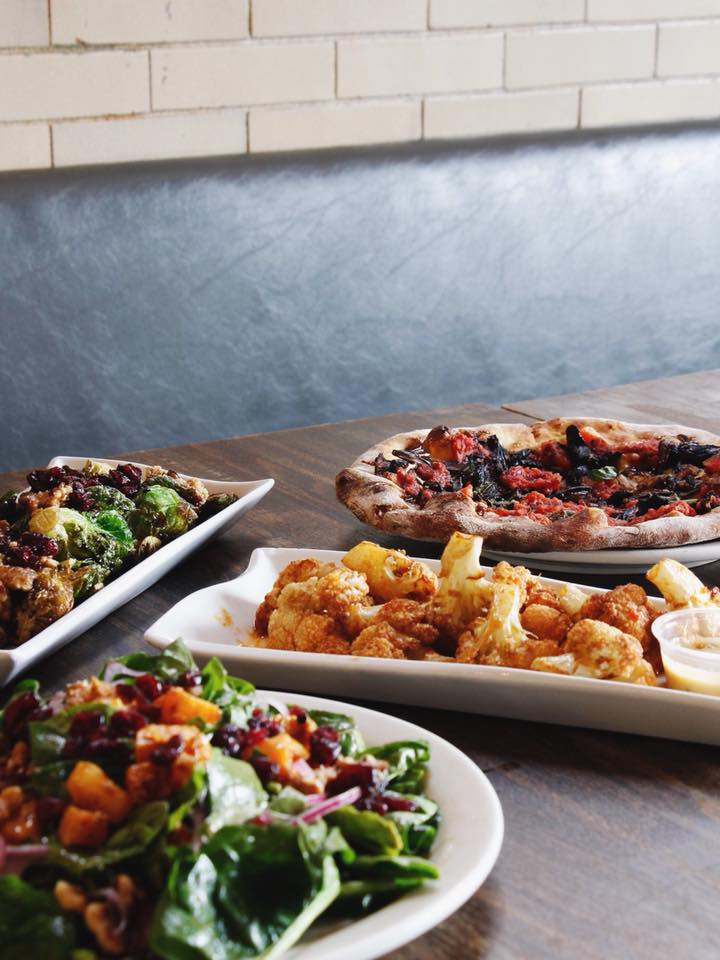 From back left: Newly updated Brussels sprouts, Funghi Pizza, Cauliflower Bites, Seasonal Salad