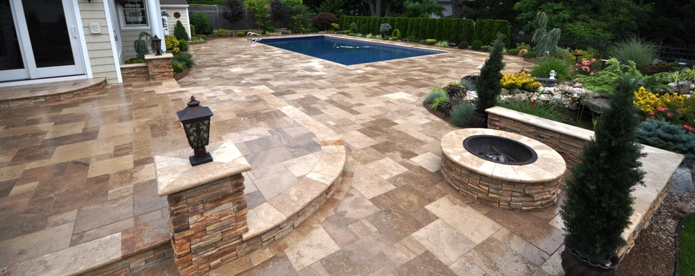 Travertine Patio With Round Firepit And Sitting Walls.