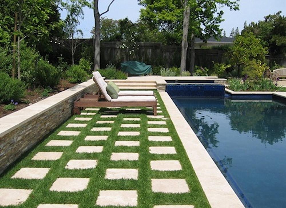concrete-pavers-grass-poolside.jpg